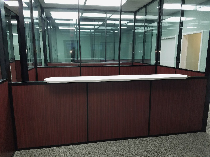 manasota-office-supplies-llc-reception-top-installation-wood-base-wall-with-glass-top-walls-flex-series-demountable-walls.jpg