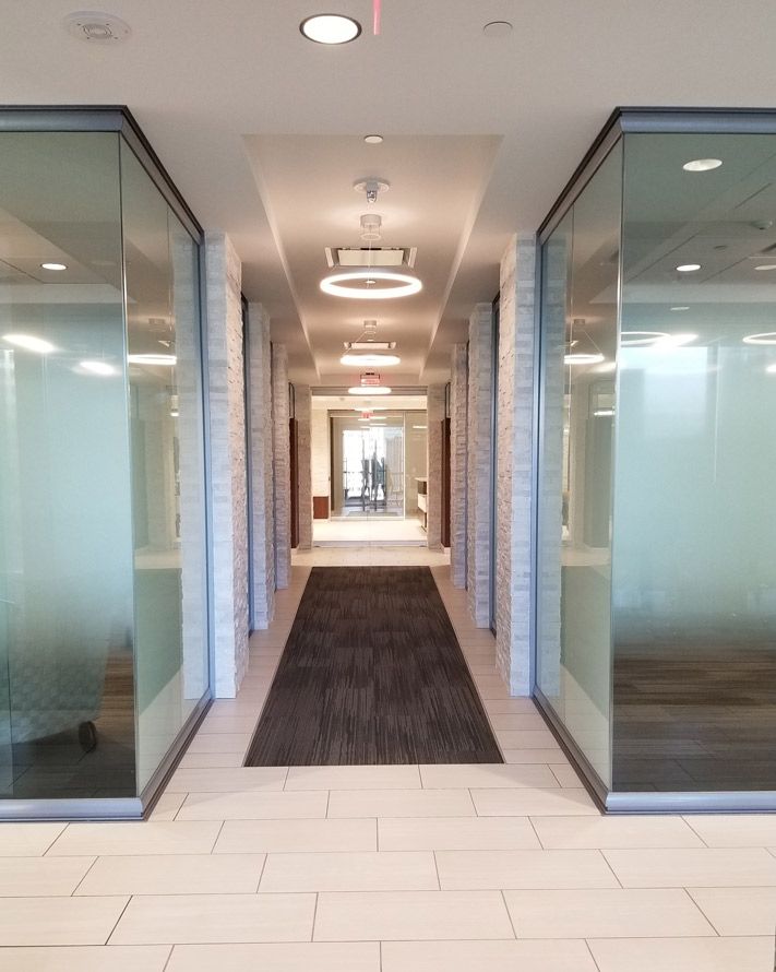 manasota-office-supplies-llc-view-series-glass-offices-integrated-with-existing-building-columns.jpg