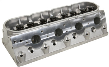 Trick Flow GenX® 215 cathedral port cylinder heads are fully CNC-machined to significantly increase the performance of 5.7L LS1 engines. Trick Flow engineers altered the valve angles from 15° to 13.5° to decrease valve shrouding, increase mid-lift airflow, and improve rocker arm-to-valve cover clearance. Top-of-the-line CNC Competition Ported runners have a premium high resolution surface finish for maximum flow and performance. The spark plugs were relocated in the CNC-profiled combustion chambers to enhance mid-lift airflow and increase the rigidity of the casting for extreme horsepower applications. Material was added at the rocker arm mounting points to increase high-rpm valvetrain stability.  Cylinder Head Style:Assembled Cylinder Head Material:Aluminum Intake Port Shape:Cathedral Intake Valve Diameter (in):2.040 in. Cylinder Head Finish:Natural Combustion Chamber Volume (cc):64 CNC-Machined Combustion Chamber:Yes Intake Runner Volume (cc):215cc Exhaust Runner Volume (cc):80cc CNC-Machined Intake Runner:Yes CNC-Machined Exhaust Runner:Yes Combustion Chamber Style:Heart Intake Port Location:Standard Exhaust Port Shape:Oval Exhaust Port Location:Standard Spark Plug Style:Angle Intake Valves Included:Yes Exhaust Valves Included:Yes Exhaust Valve Diameter (in):1.575 in. Valve Springs Included:Yes Maximum Valve Lift (in):0.600 in. Outside Diameter of Outer Spring (in):1.300 in. Damper Spring Included:No Number of Springs Per Valve:Dual Retainers Included:Yes Retainer Material:Chromoly steel Locks Included:Yes Lock Style:7 degree Valve Stem Seals Included:Yes Rocker Arm Studs Included:No Rocker Arms Included:No Rocker Arm Nuts Included:No Guideplates Included:No Valve Cover Mounting Style:Centerbolt Accessory Bolt Holes Drilled:Yes Intake Valve Angle:13.50 Exhaust Valve Angle:13.50 Valve Guides Included:Yes Valve Guide Material:Bronze Valve Seats Machined:Yes Valve Seat Machine Style:3-angle Valve Seat Material:Ductile iron Steam Holes Drilled:No Oiling Style:Through pushrod Machined for O-Ring:No Heat Crossover:No Quantity:Sold individually. Notes:Must be used with roller rocker arms. Recommended for use on engines with a minimum bore diameter of 3.900 in.