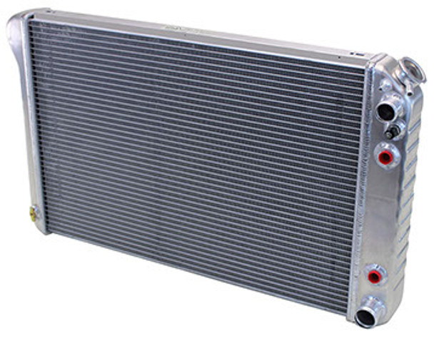 We now offer conversion radiators specifically designed for your GM truck with an LS engine and manual transmisison. They feature all aluminum construction, but unlike others on the market, they have beautifully stamped tanks with strengthening indentations just like your original. They're a double pass design putting the inlet and outlet on the same side which greatly simplifies plumbing to the engine. The all important steam port bung is welded into the upper part of the tank which lets your new LS engine vent properly. They also include a coolant temp fan switch in the tank as well as a billet radiator cap. Excellent restoration type quality made in the USA. Available in bare aluminum or black.