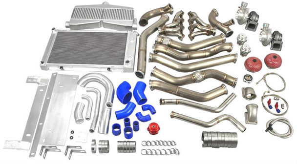 """Twin Turbo LS1 Engine Swap Kit With Radiator for 68-72 Chevrolet Chevelle Supports up to 1000 HP   Turbo Header Kit Is Designed to Fit Aftermarket AC and Alternator Brackets that Mount These Accessories High on Both Left and Right Corner   Includes: Twin Turbo Header Kit, with Two GT35 T4 Turbo and 44MM V-band Wastegate (8 PSI) Intercooler and Radiator Kit, with Mounting Brackets and Radiator Hard Pipe Kit Intercooler Piping Kit and BOV 3"""" Turbo Downpipe  Downpipes DO NOT Fit Factory Transmission Mount Cross Member, Need to Use Our Transmission Mount.  T4 GT35 Turbo Charger x2 Twin Turbo Header Downpipe Kit x1 44MM 8Psi V Band Wastegate x2 T4 to 3"""" V-Band Cast Turbo Elbow Adapter x2 Oil Filter Sandwich and Oil Line Kit x1 Set of Vband Clamp x1 Twin Turbo Intercooler, with Mounting Brackets x1 Aluminum Intercooler Piping Kit x1 Set of Silicon Hose (Blue) x1 Set of Clamp x1 50mm Blow Off Valve x1 Mushroom Air Filter x2 3 Row Big Core Aluminum Radiator with Aluminum Hard Pipe Kit  x1"""