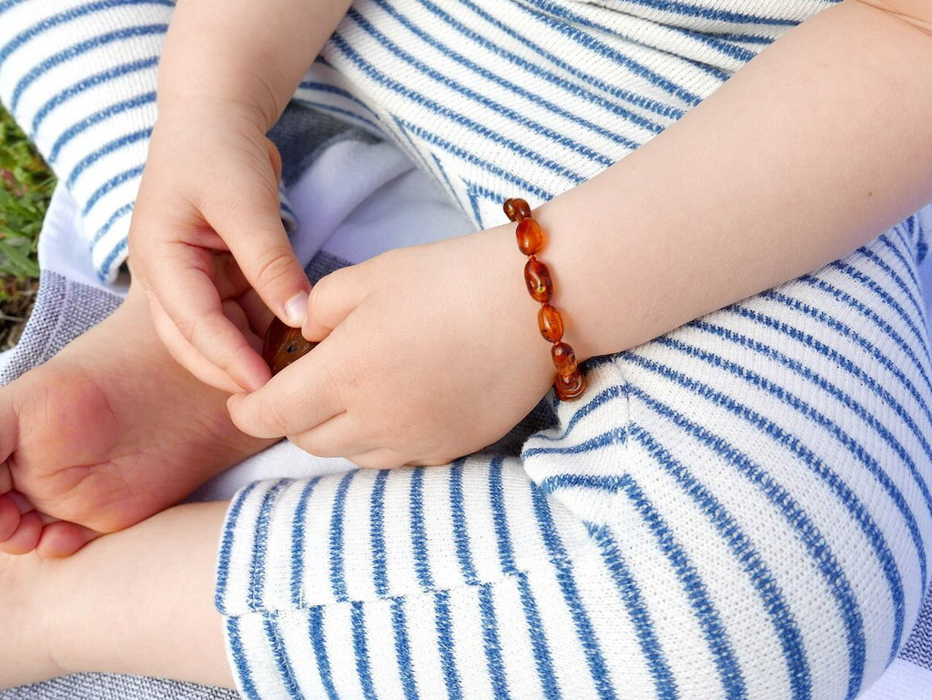 Amber teething and colic anklet / bracelet with polished cognac olive beads