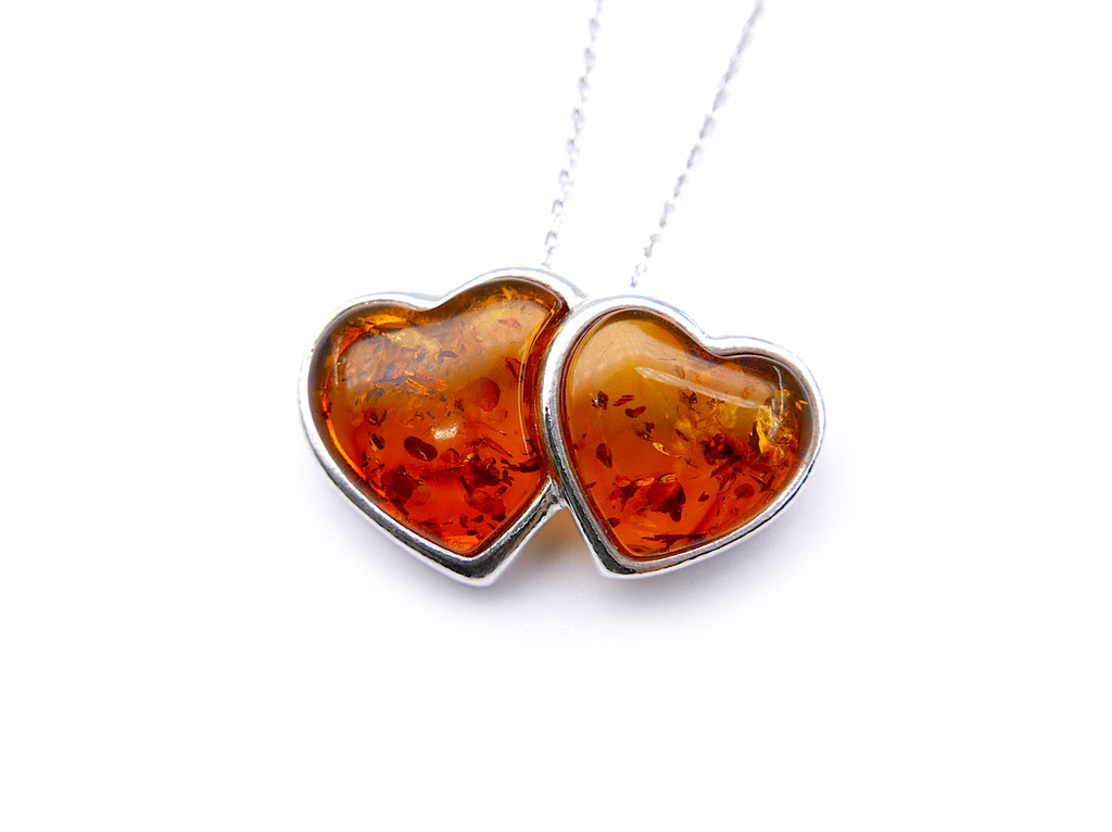 Baltic amber Double Heart pendant mounted in sterling silver