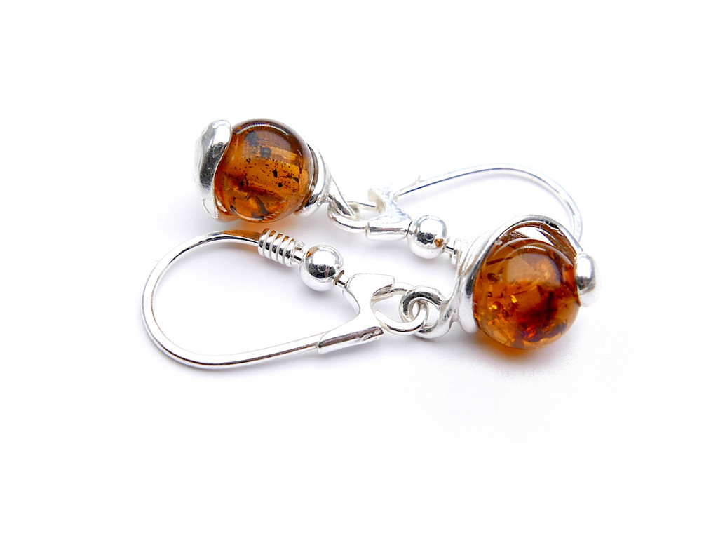 Baltic amber spheres dangle earrings in sterling silver