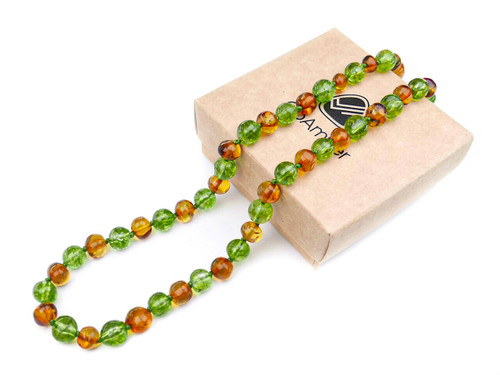 Amber teething necklace  with green peridot crystal beads