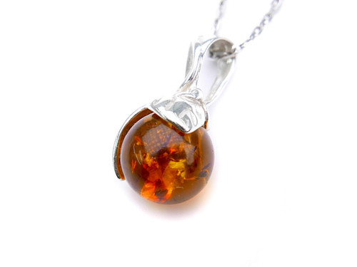 Baltic amber ball pendant in sterling silver