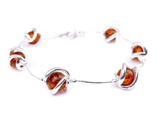 Baltic amber spheres bracelet in sterling silver