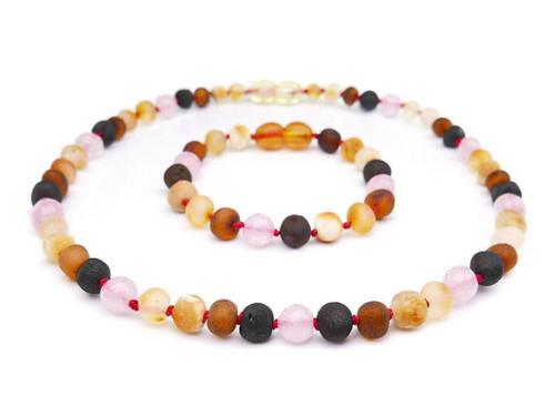 Pink amber teething set