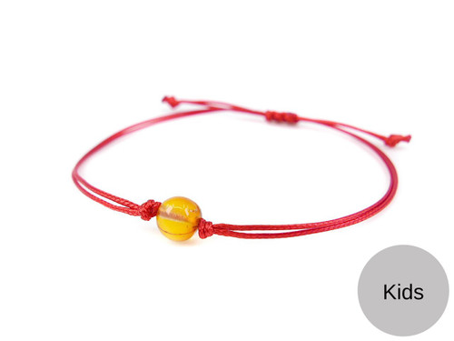 Kids Red String Kabbalah Bracelet with honey polished amber