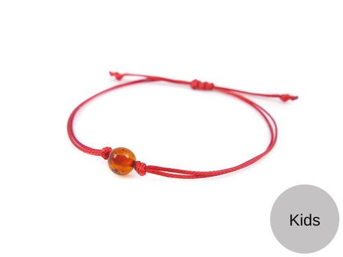 Kids Red String Kabbalah Bracelet with cognac polished amber bead