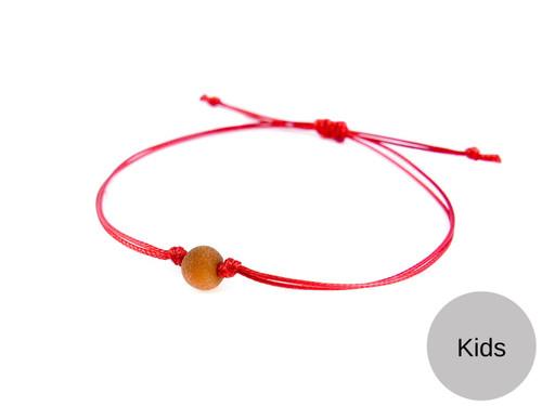 Kids Red String Kabbalah Bracelet with caramel raw amber bead