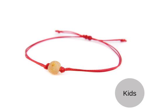 Kids Red String Kabbalah Bracelet with honey raw amber bead