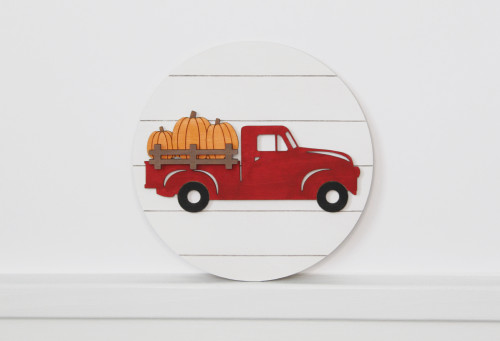 red truck with pumpkins