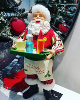 Santa table display has been handmade and hand painted holding a tray of drinks.