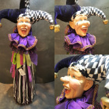 Katherine's Collection Jester wine cover display decoration, handmade and hand painted with lavish materials and trims.