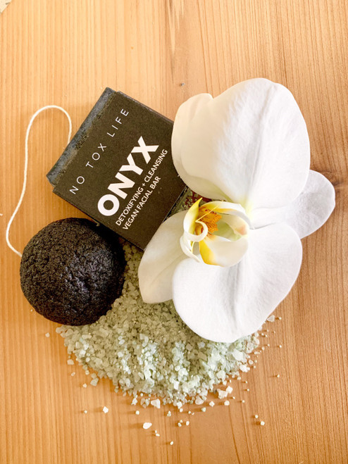 Konjac Sponge is created in Japan using the roots of the konyakku plant, a food staple for more than 1,500 years in Asian cultures. The vegetable fibers are purified and spun into a puff that is incredibly water-retentive. When used, there is a water barrier between sponge and skin which means it cleanses without scratching or irritating. The sponge is ideal for daily use, especially for those with sensitive and acne-prone skin. How to Use: For the first use, soak the sponge in warm water for 10-15 minutes until it puffs up and rehydrates. It will expand about 50% and be soft and squishy like sponge cake.