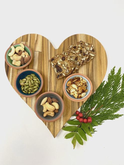 """Beautiful heart shaped charcuterie board 11"""" in height and 7"""" wide Hand cut and finished from sustainably grown teak Hand wash and dry only."""