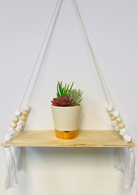 Rope hanging shelf perfect for plants, books and other decor.