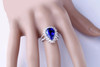 Halo Pear Cut Tanzanite and Diamond Ring