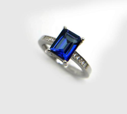 Unique Emerald Cut Tanzanite Diamond Ring AAAA