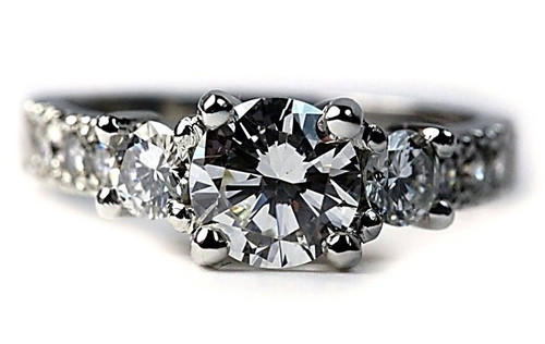 Three Stone Platinum Engagement Ring with GIA certified VVS2 F Diamond