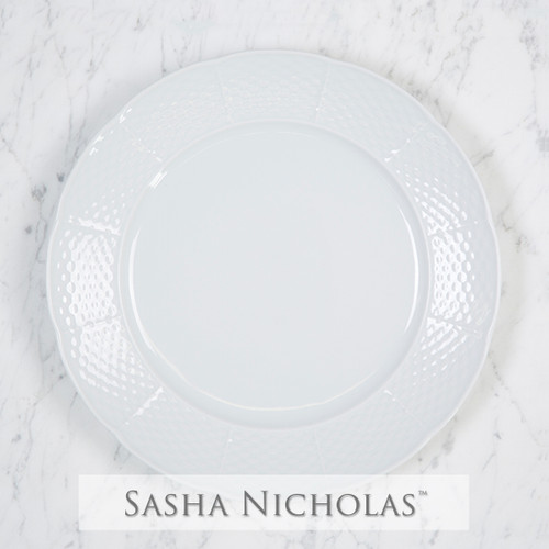A beautiful addition to your dinnerware collection and to adorn your tablescapes with. It makes the perfect gift for your wedding registry and has the option to include an inscription on back. Choose from their signature font styles or use a custom monogram or crest of your choice! | Sasha Nicholas's white porcelain weave dinner plate