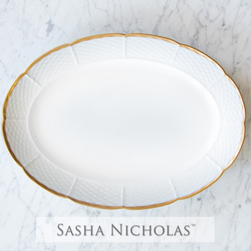 A beautiful addition to your dinnerware collection and to adorn your tablescapes with. It makes the perfect gift for your wedding registry with the included inscription on back. Choose from their signature font styles or use a custom monogram or crest of your choice! The 24K gold rim is quite stunning. | Sasha Nicholas‰Ûªs white porcelain 24K gold oval platter