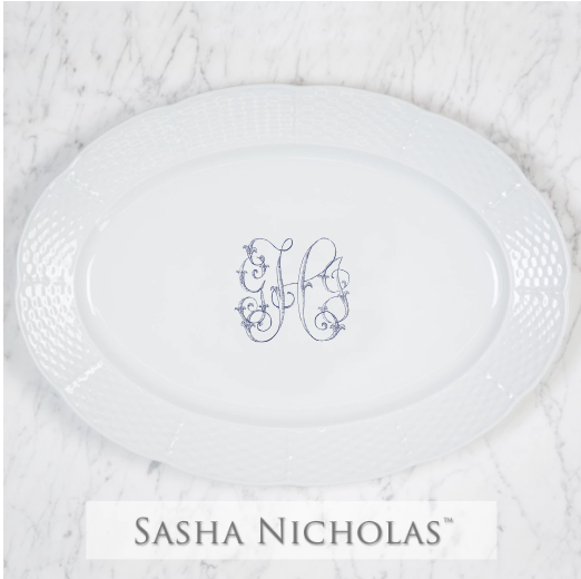 A beautiful addition to your dinnerware collection and to adorn your tablescapes with. It makes the perfect gift for your wedding registry with the included inscription on back. Choose from their signature font styles or use a custom monogram or crest of your choice! | Sasha Nicholas white porcelain oval platter