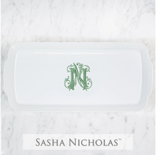 A beautiful addition to your dinnerware collection and to adorn your tablescapes with. It makes the perfect gift for your wedding registry with the included handwritten inscription on back. Choose from their signature font styles or use a custom monogram or crest of your choice! | Sasha Nicholas's white porcelain hostess platter