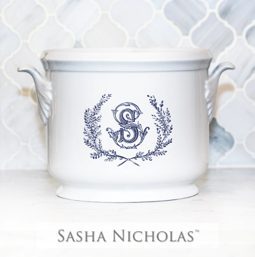 A beautiful addition to your dinnerware collection and to adorn your tablescapes with. It makes the perfect gift for your wedding registry with the included inscription on back. Choose from their signature font styles or use a custom monogram or crest of your choice! | Sasha Nicholas's white porcelain champagne bucket