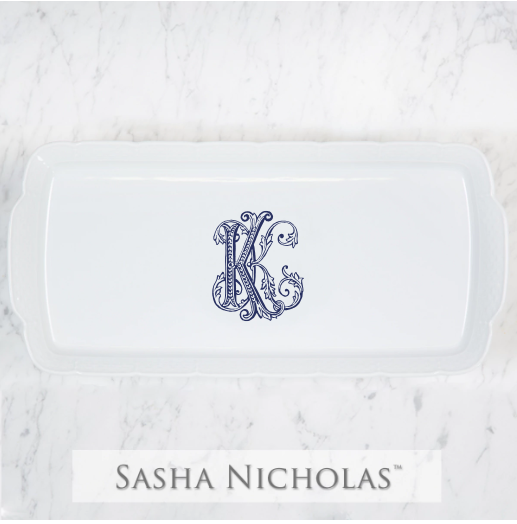 A beautiful addition to your dinnerware collection and to adorn your tablescapes with. It makes the perfect gift for your wedding registry with the included inscription on back. Choose from their signature font styles or use a custom monogram or crest of your choice! | Sasha Nicholas's porcelain hostess platter