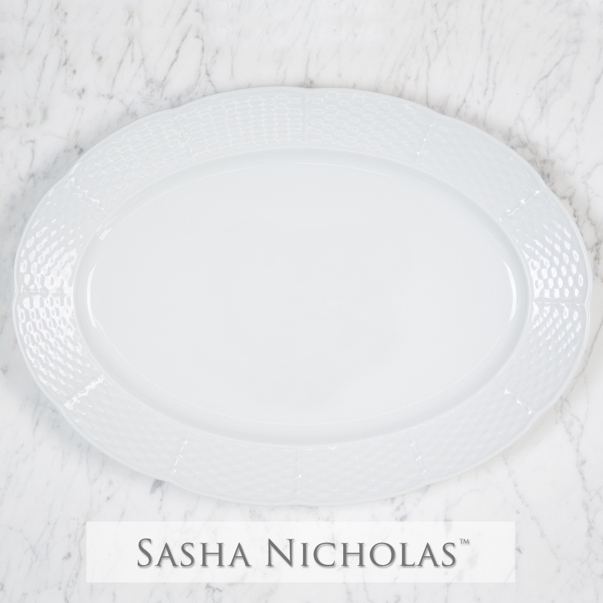 A beautiful addition to your dinnerware collection and to adorn your tablescapes with. It makes the perfect gift for your wedding registry with the included inscription on back. Choose from their signature font styles or use a custom monogram or crest of your choice! | Sasha Nicholas porcelain oval platter