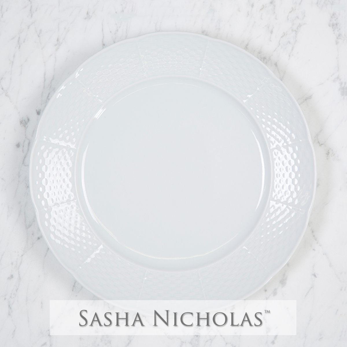 A beautiful addition to your dinnerware collection and to adorn your tablescapes with. It makes the perfect gift for your wedding registry and has the option to include an inscription on back. Choose from their signature font styles or use a custom monogram or crest of your choice! | Sasha Nicholasäó»s white porcelain weave dinner plate