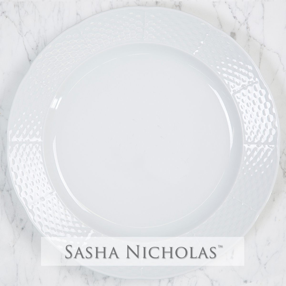 A beautiful addition to your dinnerware collection and to adorn your tablescapes with. It makes the perfect gift for your wedding registry with the included inscription on back. Choose from their signature font styles or use a custom monogram or crest of your choice! | Sasha Nicholas porcelain weave charger