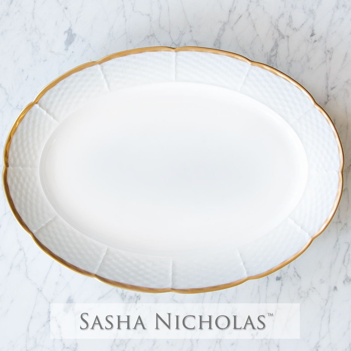 A beautiful addition to your dinnerware collection and to adorn your tablescapes with. It makes the perfect gift for your wedding registry with the included inscription on back. Choose from their signature font styles or use a custom monogram or crest of your choice! The 24K gold rim is quite stunning. | Sasha NicholasŒŠí_ŒÈs white porcelain 24K gold oval platter