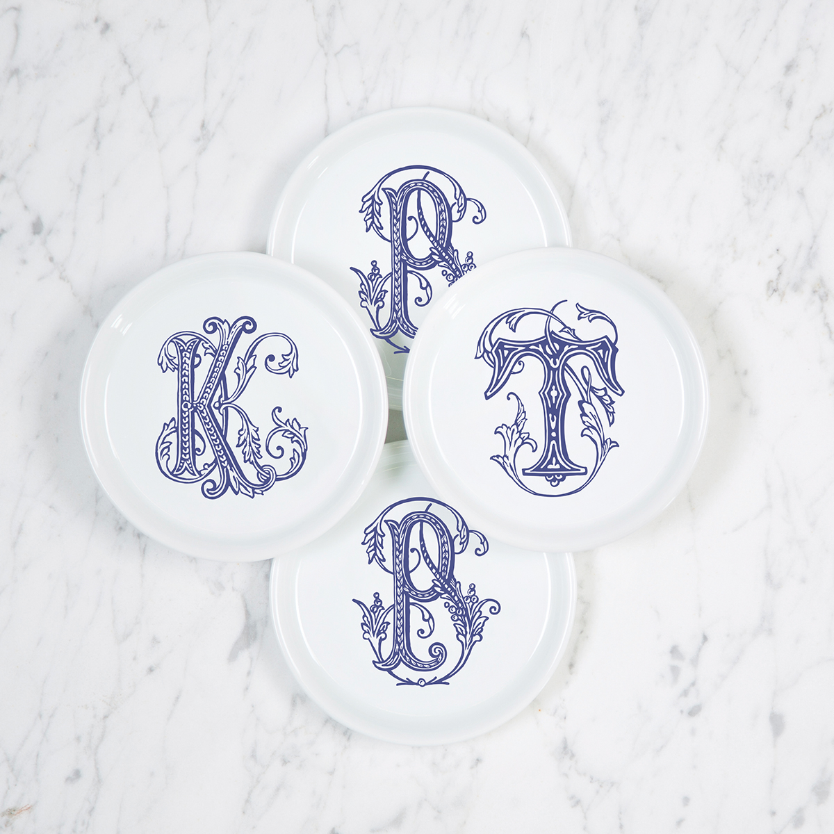 A beautiful addition to adorn your tablescapes with when entertaining and to your dinnerware collection. They make the perfect small gift for your wedding registry. The navy couture is such a classic. | Sasha Nicholas's white porcelain coasters