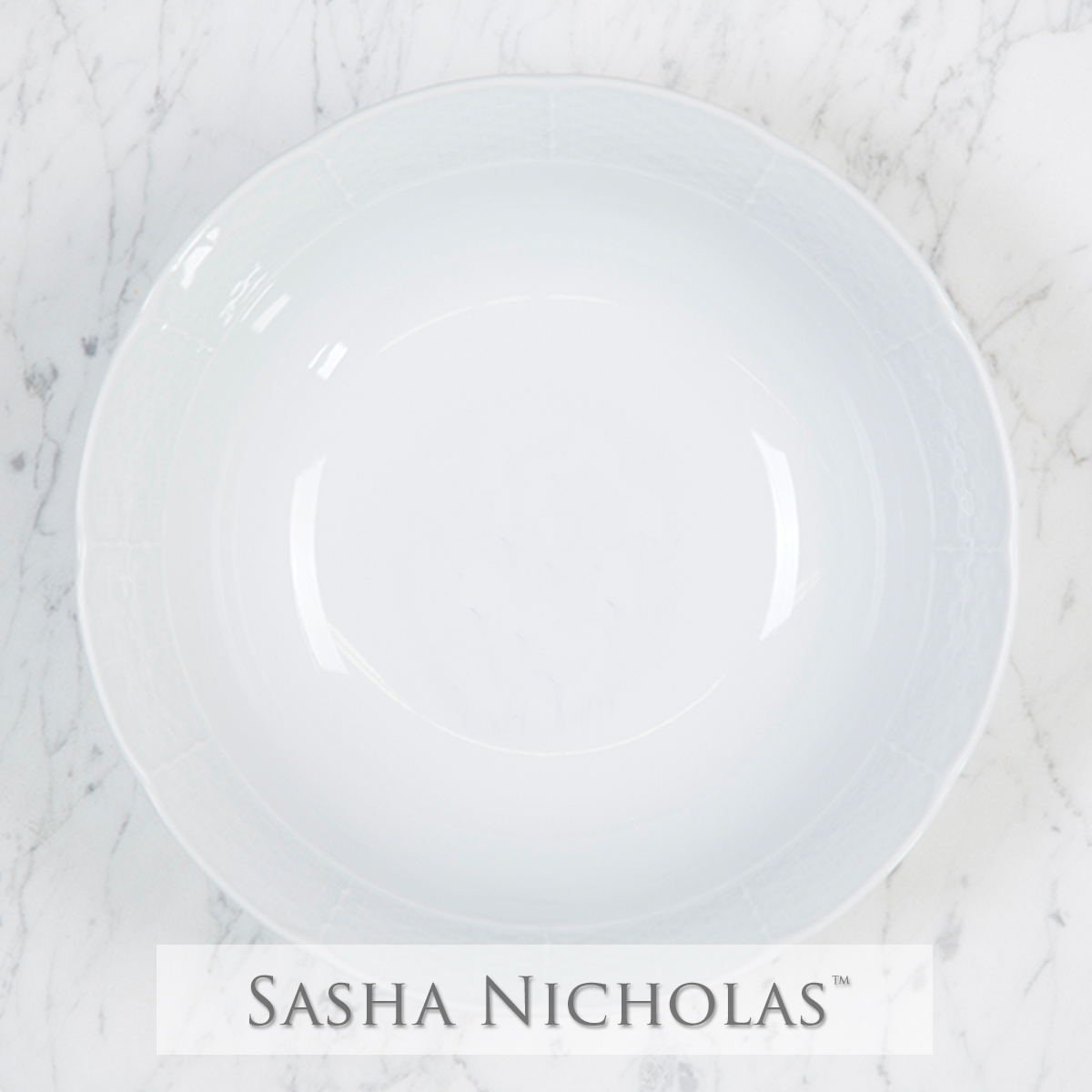 A beautiful addition to your dinnerware collection and to adorn your tablescapes with. It makes the perfect gift for your wedding registry. Choose from their signature font styles or use a custom monogram or crest of your choice! | Sasha Nicholas‰Ûªs white porcelain medium serving bowl