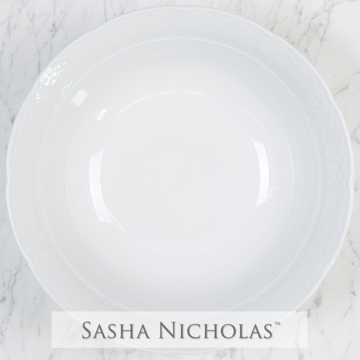 A beautiful addition to your dinnerware collection and to adorn your tablescapes with. It makes the perfect gift for your wedding registry with the included inscription on bottom. Choose from their signature font styles or use a custom monogram or crest of your choice!   Sasha Nicholas's white porcelain large serving bowl