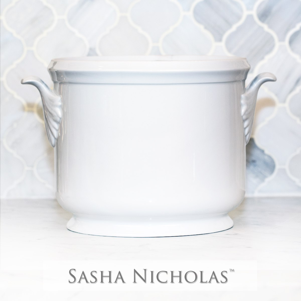 A beautiful addition to your dinnerware collection and to adorn your tablescapes with. It makes the perfect gift for your wedding registry with the included handwritten inscription on back. Choose from their signature font styles or use a custom monogram or crest of your choice! | Sasha Nicholas's white porcelain champagne bucket