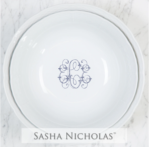 A beautiful addition to your dinnerware collection and to adorn your tablescapes with. It makes the perfect gift for your wedding registry with the included inscription on bottom of the large bowl. Choose from their signature font styles or use a custom monogram or crest of your choice! | Sasha Nicholas's white porcelain large and medium serving bowls