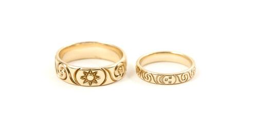 9ct Gold Wedding Rings with Celtic Spirals and Sun & Moon detail