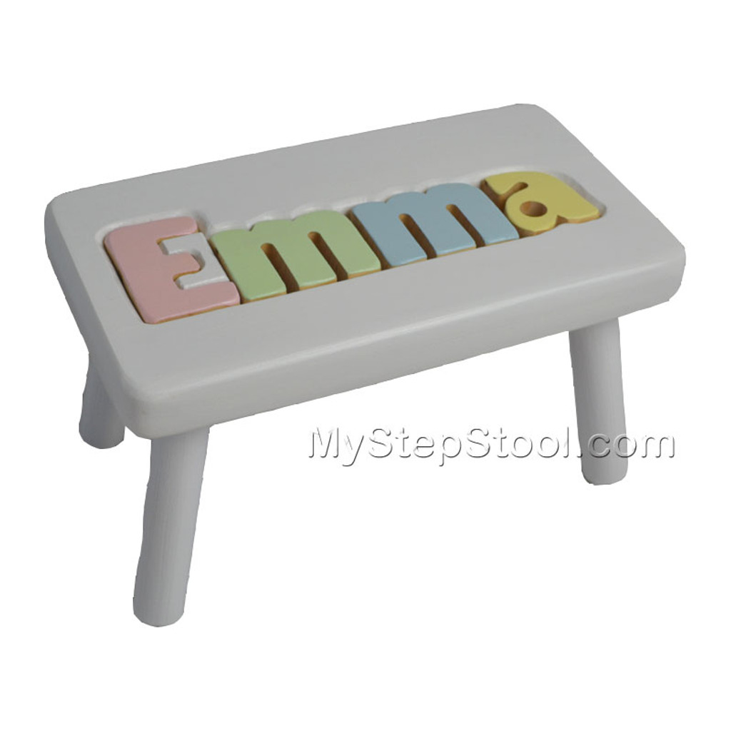 white name stool with pastel letters