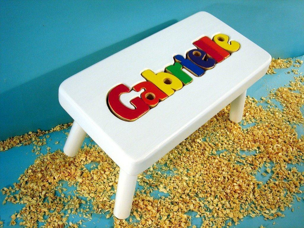 white name stool with primary letters