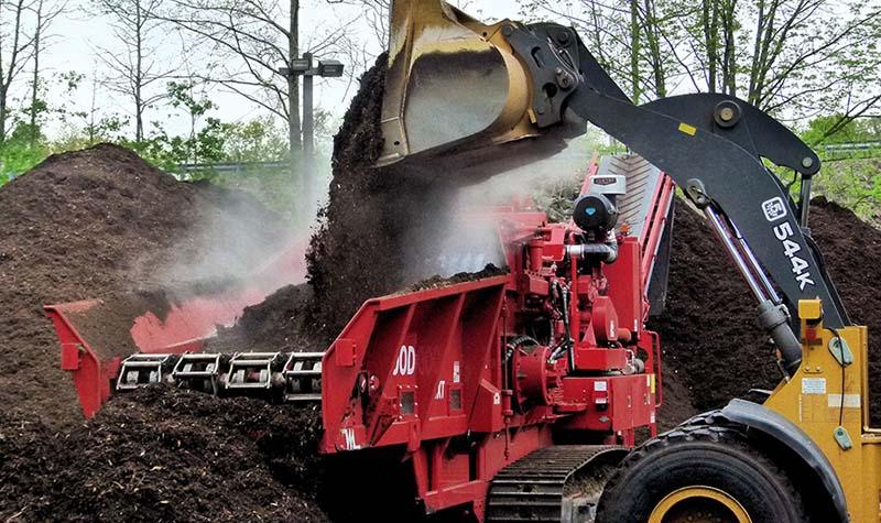 Compost grinder and loader