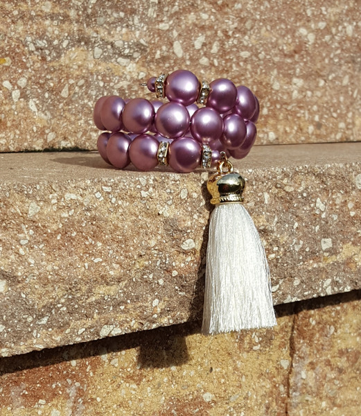 Aubergine wrap around bracelet with tassel.