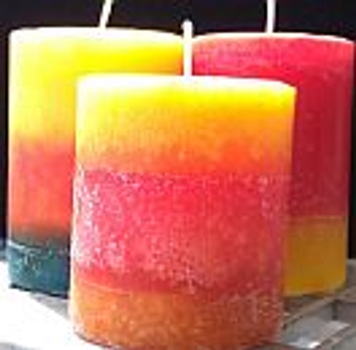 "3""x3"" Pillar Candles -Round.  three candles each with three layers. One yellow, orange, turquoise. one yellow, red, orange. one red, orange yellow.  All have paper wicks."
