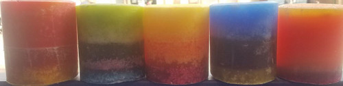"A grouping of 3"" x 3"" round pillar candles"