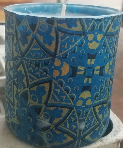 Blue star mandala design with gold and black. Uniquely scented candles in decoupaged containers. These containers are covered with paper or fabric.