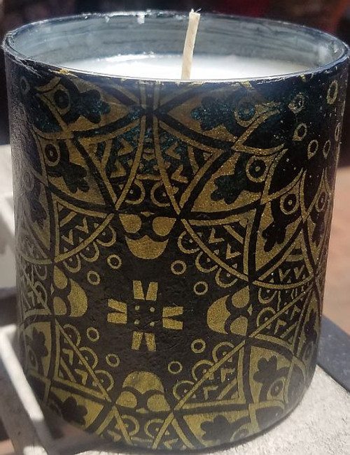 Black with mandala star design in gold. Uniquely scented candles in decoupaged containers. These containers are covered with paper or fabric.