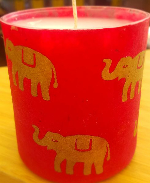 Gold elephants on magenta background. Nepalese Lokta paper is handmade in Nepal.